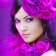 Beautiful girl in a hat with roses — Stock Photo #7617536
