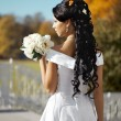 Beautiful bride in autumn park — Stock Photo #7617592