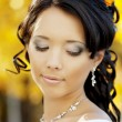 Beautiful bride in the autumn park — Stok fotoğraf
