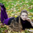 Beautiful girl in the autumn park — Stock Photo #7617655
