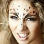 Luxury girl, like a leopard — Stock Photo