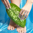 Beautiful manicured feet with a neat pedicure — Stock Photo