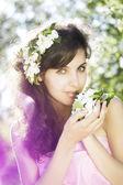 Beautiful girl was blossoming garden — Stock Photo