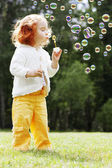 Girl puts the bubbles in the park — Stock Photo