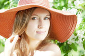 Beautiful woman among flowering gardens — Stock Photo