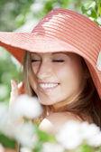 Beautiful woman among flowering gardens — Stock Photo