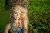 Beautiful girl in the park at sunset — Stock Photo