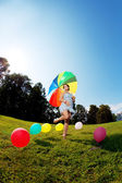 Pregnant woman rainbow umbrella — Stock Photo