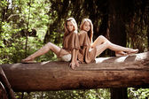 Beautiful twins in the forest — Stock Photo
