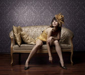 Luxurious glamorous models in gold — Стоковое фото