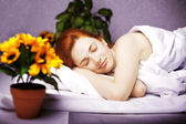 Sleeping girl in bed in his room — Stock Photo