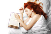 Woman who reads a book in bed — Stock Photo