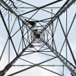 Center of high voltage pylon. Looking up view — Stock Photo