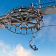 Double ski lift and the wheel with blue sky — Stock Photo