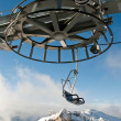Stock Photo: Double ski lift and wheel with moutain