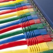 Royalty-Free Stock Photo: Multi colored ethernet network cables connected to a router