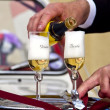 Wedding - Pouring Champagne to Groom and Bride Glasses — Stock Photo #7476368