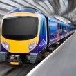 Modern Passenger Commuter Transport Train with Motion Blur — Stock Photo #7476752