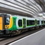 Modern Passenger Commuter Transport Train Side with Motion Blur — Stock Photo