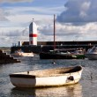 Royalty-Free Stock Photo: Small Boat tied in a harbour with Lighthouse
