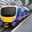 Modern Passenger Commuter Transport Train with Motion Blur — Stock Photo #7476861