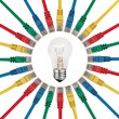IT Ide- Lightbulb in centre of colored network cables — Stock Photo #7477216