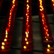 Vertical Rows of Red Church Candles — Stock Photo