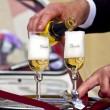 Wedding - Pouring Champagne to Groom and Bride Glasses — Stock Photo