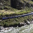 Stock Photo: Train to Machu Picchu with Urubambriver