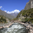 Wild Urubamba river flowing through valley - Stock Photo