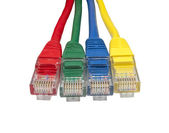 Set of four brightly multi coloured ethernet network plugs — Stock Photo