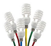 Bright Ideas - Fluorescent Light Bulbs attached to a colored network cables — Stock Photo
