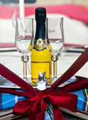 Groom & Bride Wedding Glasses and Yellow Champagne Bottle — Stock Photo
