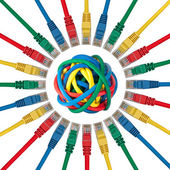 Ethernet cable plugs pointing to a ball of colored cables — Stock Photo