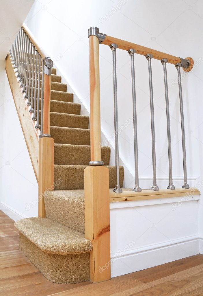 Modern House Interior -  Typical UK British Stairs with Chrome Railing with Beige Carpet. Looking up  Stock Photo #7474709