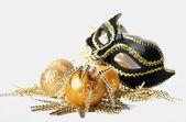 Christmas background with mask and baubles — Stock Photo