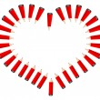 Heart made of red pencils — Stock Vector