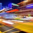 High speed and blurred bus light trails in downtown — Stok fotoğraf
