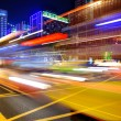 High speed and blurred bus light trails in downtown — Stock Photo #7470325