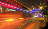 High-speed vehicles blurred trails on urban roads — Stock Photo