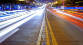 High speed traffic and blurred light trails — Stock Photo
