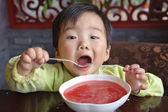 Cute baby drinking soup — Stock Photo