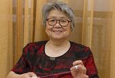 Sewing grandma — Stock Photo