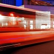 High speed and blurred bus light trails in downtown nightscape — Stock Photo #7524504