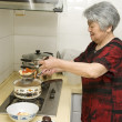 Cooking grandma — Stock Photo #7524589