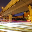 High speed traffic and blurred light trails under the overpass — Stock Photo