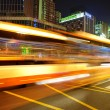High speed and blurred bus light trails in downtown nightscape — Stock Photo #7524737