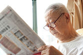 A senior man is reading — Stock Photo