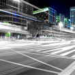 High speed and blurred bus light trails in downtown nightscape — Stock Photo #7535953