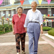 Happy senior couple are walking — Stock Photo